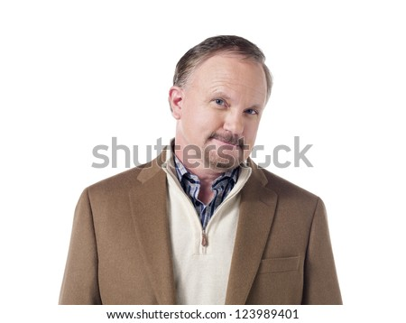 Successful senior businessman smiling while looking at the camera - stock photo
