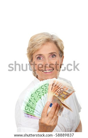 Successful senior woman holding  a group of money and smiling isolated on white background,copy space for text message - stock photo