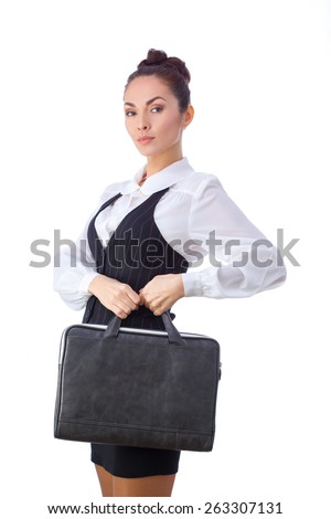 Successful Serious Caucasian Businesswoman or Teacher  With Briefcase. This photo has been produced with these professionals : make-up artist, hair dresser and stylist. A professional retoucher gave - stock photo