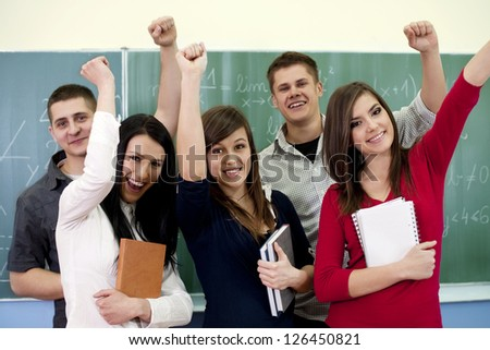 Successful smiling students - stock photo