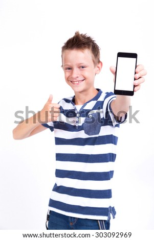 Successful student with a phone in his hand screen to the client on a white background shows the application photo with depth of field - stock photo