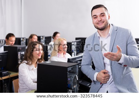 Successful supervisor giving instructions to office staff