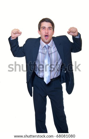 Successful surprised young handsome businessman with clenched fists over white background. Celebrating happy news