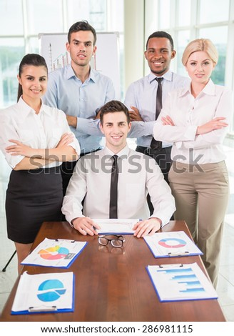 Successful team leader with his team at meeting room. - stock photo