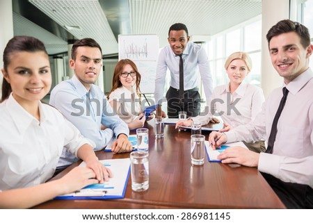 Successful team leader with his team at meeting room. Team work concept. - stock photo