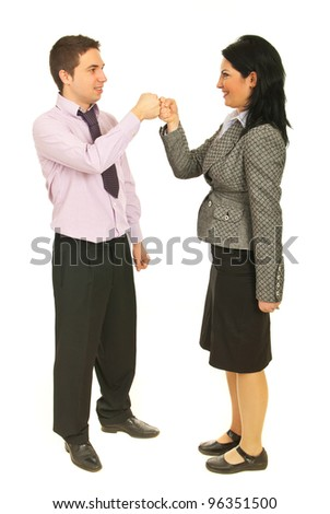 Successful teamwork holding their fist together and smiling isolated onw hite background - stock photo