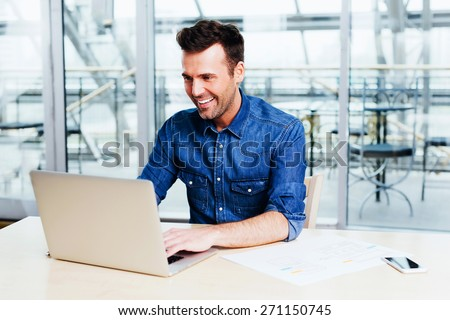Successful web designer testing the usability of his application - stock photo