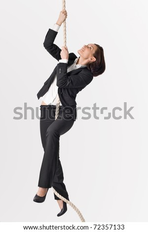 Successful woman climbing up to career - stock photo