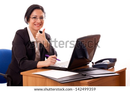 Successful woman in career at her desk. - stock photo