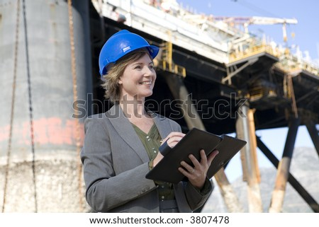 Successful woman oil platform engineer - stock photo