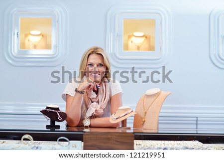 successful woman portrait - jewelry  small business owner - stock photo