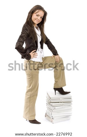 successful woman standing on the pile of files (white background) - stock photo