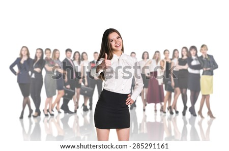 Successful woman standing with their staff in background isolated on white - stock photo