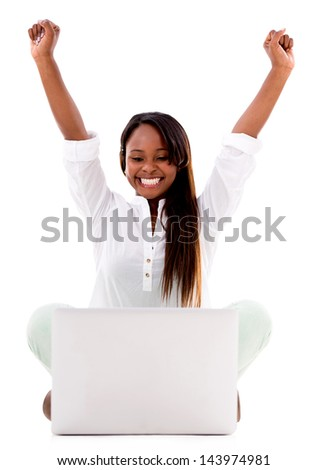 Successful woman with a laptop computer and arms up - isolated over white - stock photo