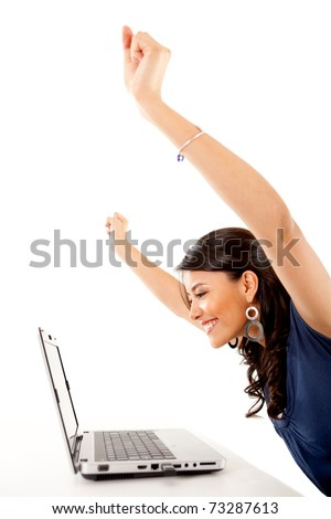 Successful woman working on a laptop computer � isolated over white - stock photo