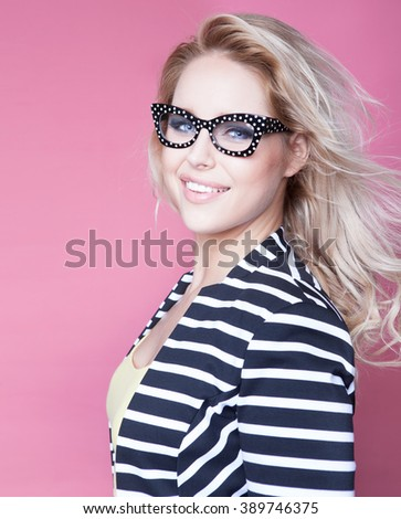 Successful young attractive blonde woman wearing glasses - stock photo
