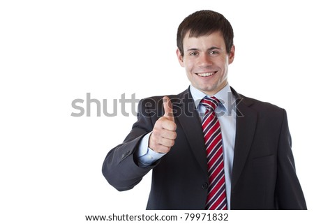 Successful young business man holds thumb up.Isolated on white background. - stock photo