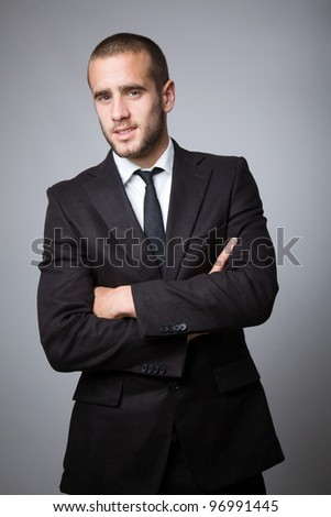 successful young business man on gray background