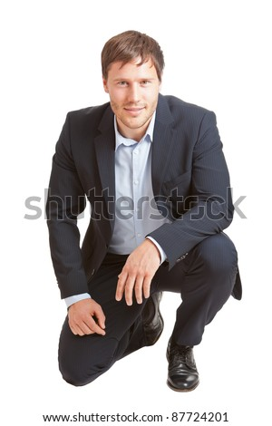 Successful young business man smiling into camera isolated on white background - stock photo