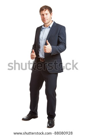 Successful young business man with thumbs up isolated on white background - stock photo