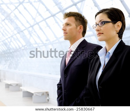 Successful young business people looking away. Copyspace. - stock photo