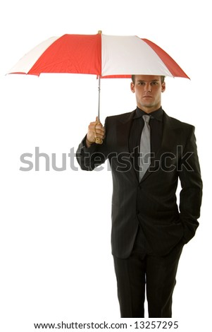 Successful young business person holding an umbrella