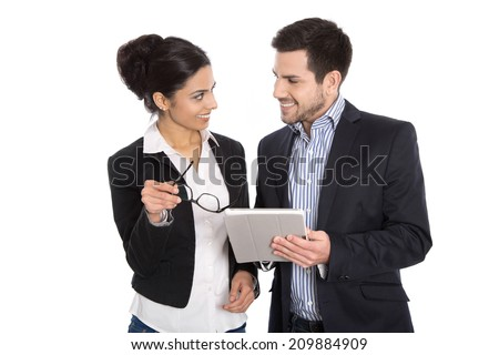 Successful young business team. Man and woman isolated over white with tablet. - stock photo