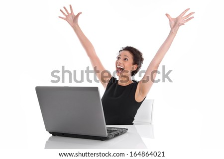 Successful young business woman at desk with computer - Stock Photo - stock photo