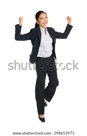 Successful young business woman happy for her success. Isolated full body image on white background. - stock photo