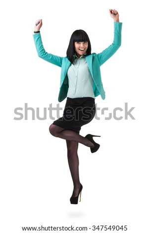 Successful young business woman happy for her success jumping. Isolated full body image on white background. Caucasian businesswoman. - stock photo