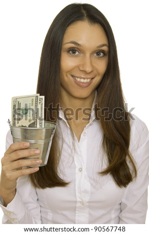Successful young business woman holding an iron bucket with dollars. Isolation - stock photo