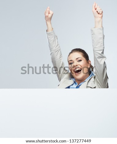 Successful young business woman portrait out the blank white banner.Female happy model.