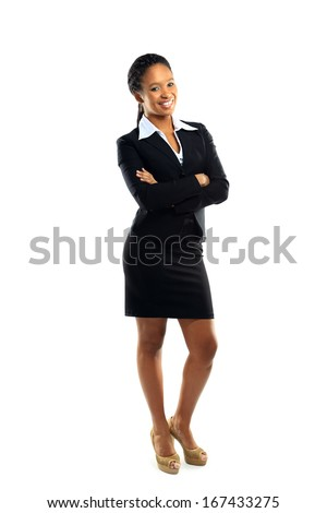 Successful young business woman with hands folded against white background  - stock photo