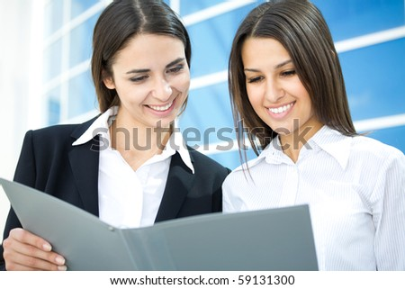Successful young business women with charming smile