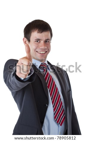 Successful young businessman is pleased holding thumb up. Isolated on white background. - stock photo