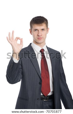 Successful young businessman shows gesture okay. - stock photo
