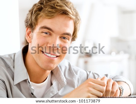 Successful young businessman working from home looking at camera a