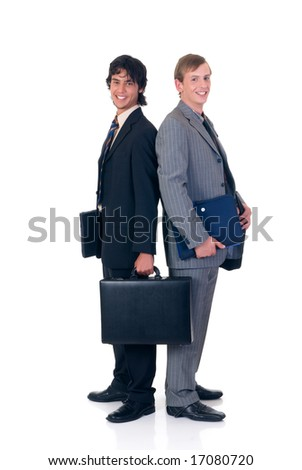 Successful young businessmen, standing back to back as a team.  studio shot, white background