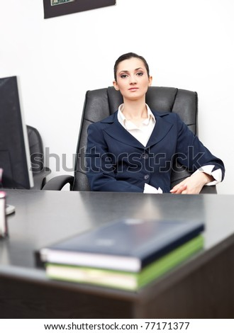 successful young businesswoman in office - stock photo