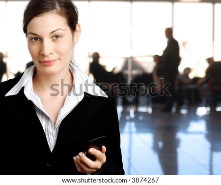 Successful young businesswoman is posing in the lobby. - stock photo