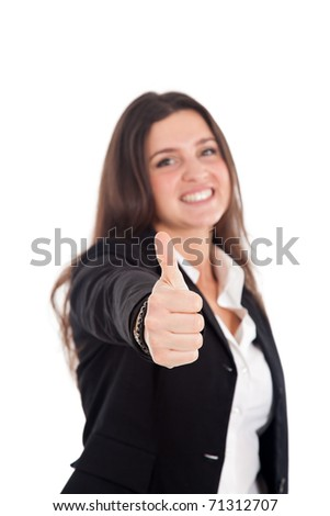 Successful young businesswoman showing thumbs up sign - stock photo