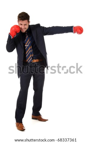 Successful young caucasian businessman wearing boxing gloves. Left hand punch. Studio shot. White background. - stock photo