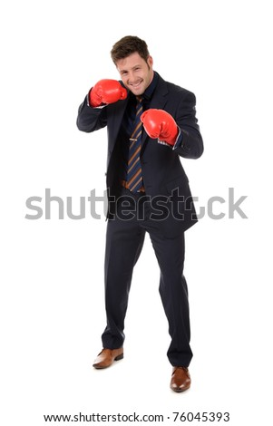 Successful young caucasian businessman wearing boxing gloves. Left hand short punch. Studio shot. White background. - stock photo