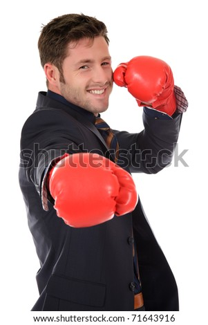 Successful young caucasian businessman wearing boxing gloves. Studio shot. White background. - stock photo