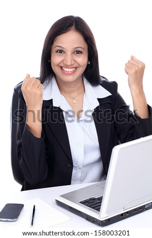 Successful young Indian business woman against white background - stock photo