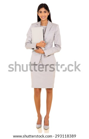 successful young indian businesswoman holding laptop on white background - stock photo