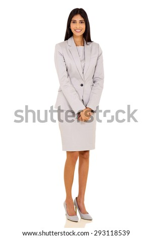 successful young indian corporate worker posing on white background - stock photo