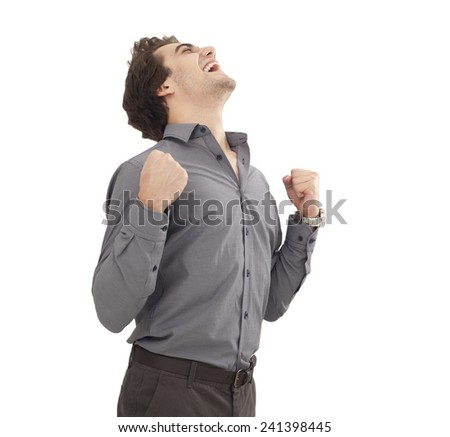 Successful young man arms up - stock photo