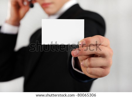 successful young man with a business card - stock photo