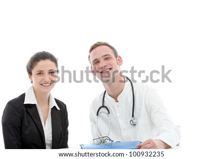 Successful young medical team of a smiling young male doctor sitting beside a female consultant or specialist physician - stock photo